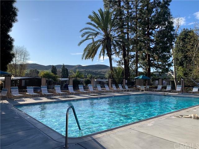 Beautiful Pool area features views of the Hills and is heated all year round. Clubhouse has been updated and  features Large recreation room, Pool room, library, conference room and state of the art exercise room