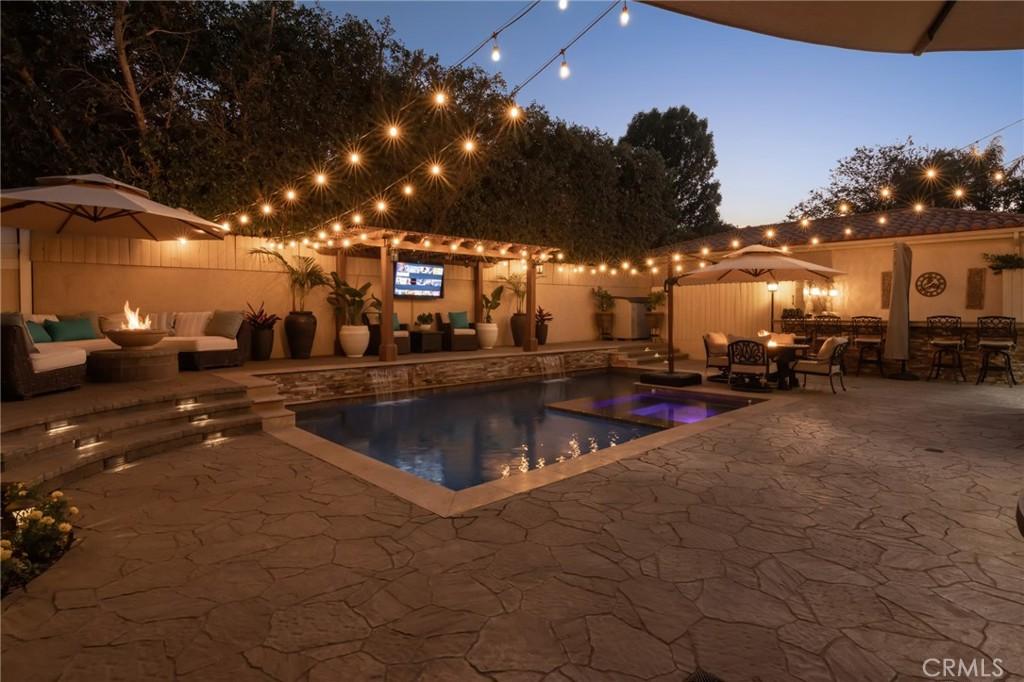 Twilight view of backyard.