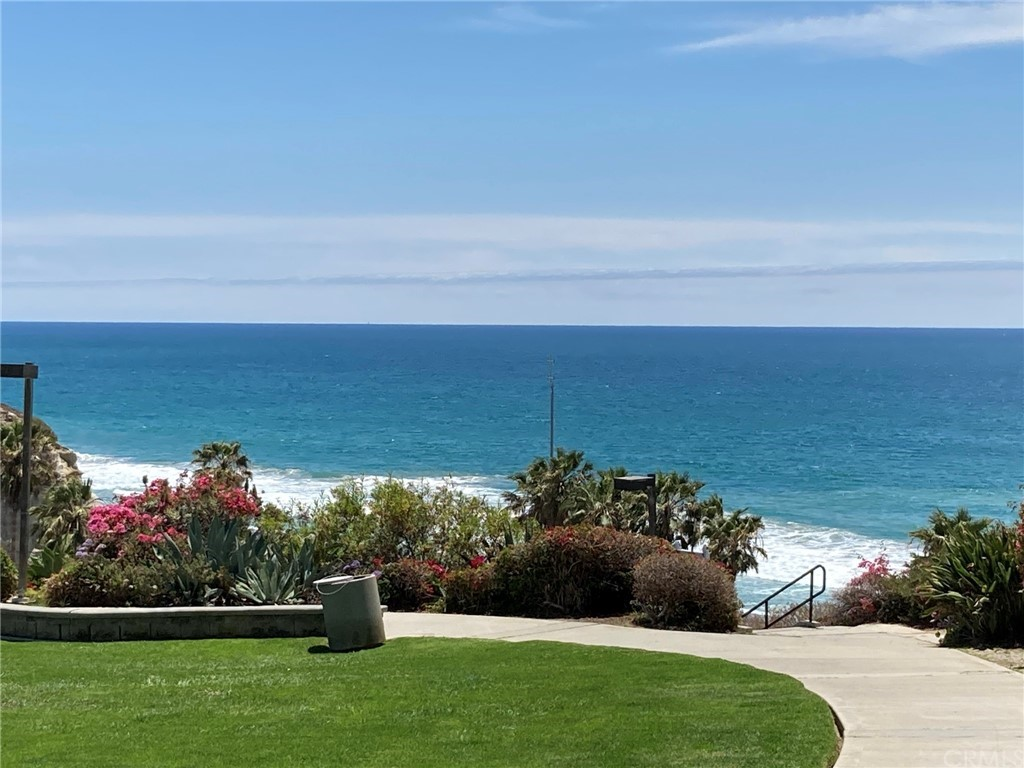 Steps to the beach…. Beautiful beach fourplex in the heart of San Clemente.  Rare opportunity to purchase a residential income property, this close to the beach.  Ocean view from upstairs.  Each unit has its own garage, as well as driveway space.  This beach beauty has four units, three of the units are two bedrooms and two baths and one unit is two bedrooms and one bath.  Rounding off the charm of this beach close fourplex, is a common area shared with the neighboring fourplex creating a wonderful courtyard effect.  All units are currently rented.  Contact agent for showing.  Buyer to confirm all information on the MLS. Escrow and Title to be WFG National Title.