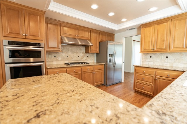 Kitchen with beautiful cabinetry and stainless steel appliances.