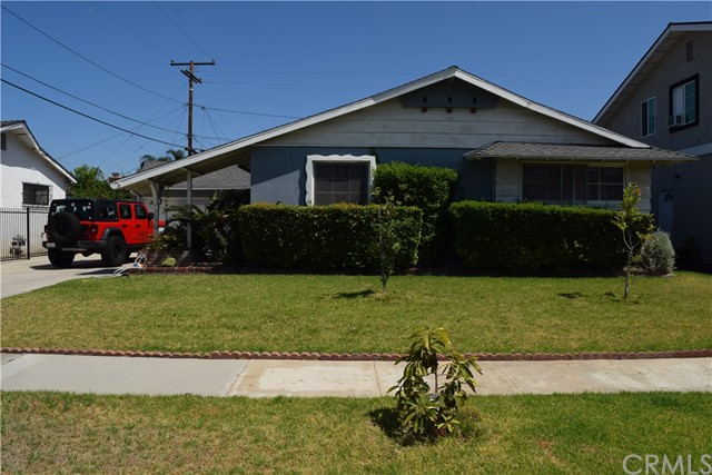 """PRICE REDUCTION !! Great family home in Buena Park """"Santa"""" tract.  Quiet and safe neighborhood, close to top rated schools in the Anaheim School District.  Convenient access to both the 91 and 5 freeways.  Walking distance to Knotts Berry Farm, Buena Park Mall and Senior Community Center!  This house is located on a beautiful street.  Upon entry, you will notice the open floor plan with newly update hardwood floors.  The kitchen is upgraded for the chef in your family.  The kitchen opens up into the living room, where you can huddle around the updated fireplace for those chilly nights.  Bathrooms have new flooring.  This house has a soft water filter, solar panels and an updated sprinkler system.  Fruit trees in the backyard.  Welcome Home!"""