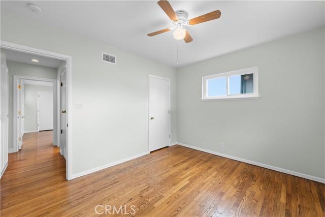 Bedroom 2 Adjacent to Hall Closets and Bathroom 1