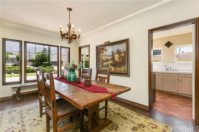 Formal Dining Room with Hardwood Floors and Wood Windows