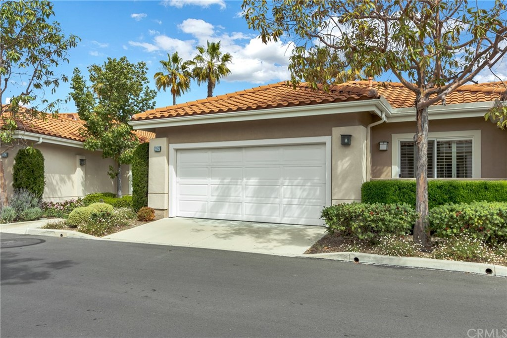 Don't miss out on your opportunity to live the good life in this rare-to-market end unit adjacent to a tree-filled greenbelt in the heart of one of Orange County's most desirable & active 55+ Resort-Style Communities: Palmia. With only 1 shared wall & a 2-car garage (direct access by stair or removable ramp), this nearly 1,700 sq. ft. 3 bed, 2 bath home is the largest model within the Courts.  Recent upgrades to your home include: carpet, paint, ceiling fans, laminate & tile flooring (no stairs/steps in your home–not even to the front door), an updated kitchen with engineered stone counters, under cabinet lighting, a center island, & modern tile back splash. Your new home is filled with natural lighting via large picture windows, sliding doors & skylights; it has also been completely re-piped in the last 5 years. Relax on your oversized patio shaded by an aluminum patio cover & featuring a low block wall topped with iron railings. Community amenities include: 18-hole putting green, multiple pools, spas, a state-of-the-art workout facility, clubhouse with library, tennis & sport courts, bocce, shuffleboard, & billiards. Palmia is one of the most engaging 55+ communities around with a host of social clubs for all interests, classes, & a variety of activities/outings scheduled throughout the year.  Also included with your new home is a membership to the Lake Mission Viejo Association that includes lake privileges & beach access, shows & concerts, & a variety of seasonal events.