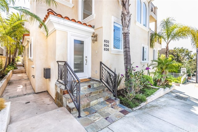 Flagstone steps lead you up to the front door