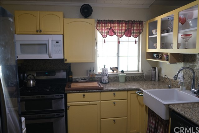 Range, Microwave and Farmhouse sink for great kitchen.