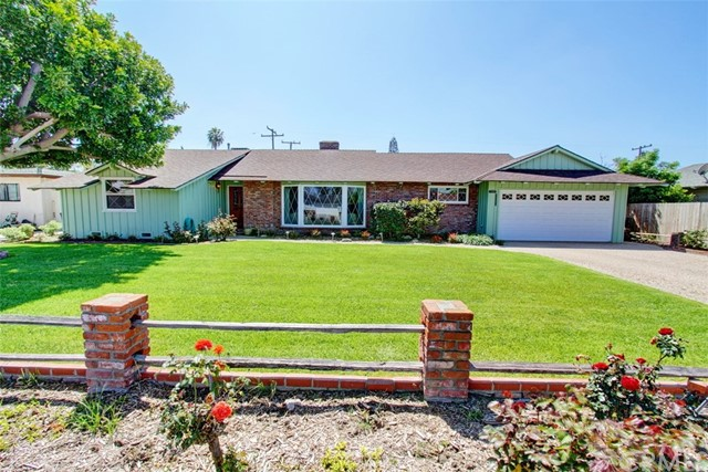 Ultra charming Mid century Custom built Garden Grove Estate, rarely on market in over 54 years. From front formal entry into an open , spacious  living room with custom built brick fireplace and beautiful front lawn view.  Formal dining room creating a warm and inviting space. Country kitchen with its own dining area offers a friendly feeling of traditional but very elegant for your own taste. This open concept floor plan from kitchen flows right into a cozy family room with one of a kind focal point brick fireplace. All three good size bedrooms with large windows and generous closet space. Two functional updated full baths. Convenient interior laundry room with its own half bath / extra storage space and direct access from two car attached garage. Other features include double pane windows , copper plumbing , newer roof , central Heating & AC, sprinkler system , wood  shutters , garden /bay windows  and recently painted outside. Attractive Outdoor patio and sparkling pool, grassy area for children to play , family gatherings and plenty of room for future expansion on this humongous all block wall surrounding back yard. Excellent curb appeal and Professional landscaping front & back. Large custom gravel drive way offers  ample parking spaces . This is truly one of the most well taken care loving  family homes in town , located in a warm and family friendly neighborhood with walking distance to schools, Churches, Temples , local markets and easy access to Freeways. A MUST SEE