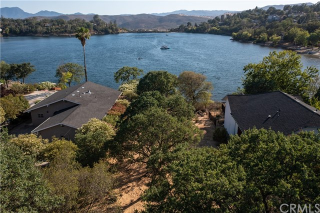 RARE LAKEFRONT OPPORTUNITY! This 1/3 acre LAKEFRONT parcel is located on Beautiful Hidden Valley Lake, just 20 miles North of Calistoga. Are you ready to build your LAKEFRONT DREAM HOME? Imagine summers soaking in the spectacular 360 degree lake and valley views from your very own backyard or taking a dip at your convenience. BONUS: Paid water meter is included, which is a $9,600 savings according to the local water company! The crystal blue, private lake is 102 acres and stocked with fish annually. Lakefront parcels on North Shore are highly sought after - don't miss your chance to snag this one up! Hidden Valley Lake is a gated community featuring, parks, fishing piers, beaches, marina, clubhouse, pool, tennis, hiking trails, pro shop, 18 hole championship golf course, restaurant and more. The good life awaits!  vHJ6B_NvA9M