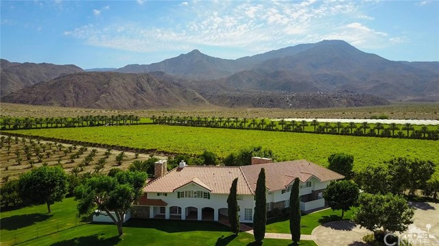 The prestigious Keck Estate offers ultimate privacy on your own 300-acre ranch, just minutes from all the dining and shopping that La Quinta has to offer. The impressive estate is adorned with breathtaking panoramic views of the Santa Rosa mountains, its own private date orchard and grape vineyard, a sprawling 10,000 square foot home, 2,016 sq. ft. 11 beds and 10 1/2 bath estate and guest home, 10 stall barn with apartment, and mobile home. Take advantage of this rare and exciting opportunity to own one of the most captivating properties in the Coachella Valley! APNs 753-070-007, 008, 018, 028, 030, 031, 753-080-004, 013, 753-090-010 also included in sale.