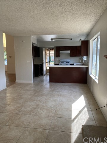 Freshly painted, new flooring installed, beautiful house with master bedroom 2 full bathroom, separate living room and family room, updated kitchen with granite counter, direct garage access. washer / dryer hook ups are located in the garage.