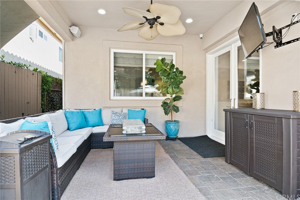 Covered patio with ceiling fan.