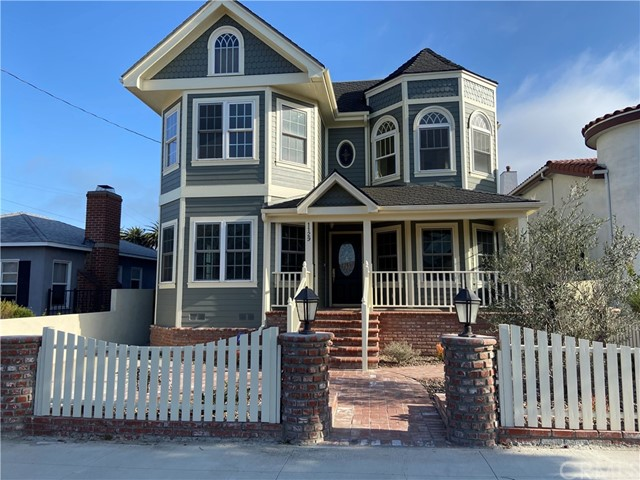 """Welcome home to 1129 W 20th Street. Custom build in 2003.This kind of home rarely comes for lease. A luxurious 4 bedroom 5 bath Victorian gem is located in heart of San Pedro. This chic residence is nearly 3000 sq. ft. and was expertly designed to marry the serenity of a life by the sea with the pride and luxury of resort-style living. In this prime Vista Del Oro location, you area surrounded by the best of California coastal living. The inviting porch opens to newly refinished  hardwood floor with the long entry hallway and staircase. Main level enjoys a guest bedroom ensuite, living room with fireplace, powder room, formal dining room, spacious family room and kitchen area with pantry and breakfast nook. The gourmet kitchen is equipped with all new appliances,36"""" stove/oven and new side by side frig and dishwasher. Custom cabinets and center Island are adorned in granite. Upstairs you will find landing area with plenty cabinets space with laundry room, master suite with sitting area and huge master bath with soaking tub, separate shower with walk in closet. Two addition bedrooms also ensuite on opposite side. Home enjoys huge 800 sq. ft. basement / game room and separate office. The rear yard has a large patio perfect for family get together. The two car garage has a bath / shower and 600 sq. ft. room above, perfect for guest, office or play room. Addition feature include motorized rear gate for ease in / out access. Two AC and heating units, new land scaping, alarm system, camera system, speakers thru-out , wall mounted prewired locations for tv's, Cat 5 wiring, huge storage area. Four cars parking space, one parking space at front and one of the rear gate plus  a two car garage."""