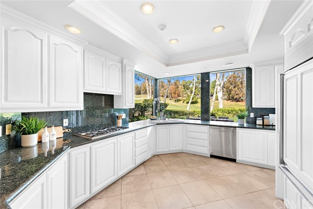 Kitchen virtually enhanced with white cabinets
