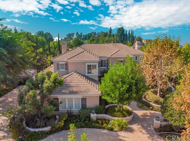 Welcome to your new home! Located in the highly sought-after Raymond Hills in the foothills of Fullerton, CA. This private gated estate is tucked away amongst lush foliage within an expansive lot boasting over 30,000sqft. Beautifully landscaped with an exterior built-in barbecue grill with granite counter and shaded dining pavilion create the perfect entertaining ambiance. A resort-like pool and spa provide a wonderful, tropical quality, fully equipped with a waterfall and a slide perfect for get-togethers! The circular drive-way with 3-car direct access garage offers plenty of parking spaces for all your cars and extra guests. A downstairs bedroom and private bath offer convenience for family/guests. High ceilings and excellent natural lighting create an elegant, well-designed home. The spacious kitchen has a built-in gas range, refrigerator, and an island to boast. Award winning schools, Acacia Elementary & Troy High School offer top-notch education. Take pride in owning this extraordinary estate nestled within the finest properties in Fullerton, and only being minutes away from I-57, I-91, I-55, and I-5 Freeways make this the complete package!