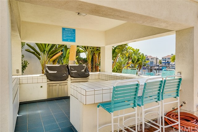 This Well Equipped Outdoor Kitchen and Bar Area is a Fabulous Place for Your Gatherings.