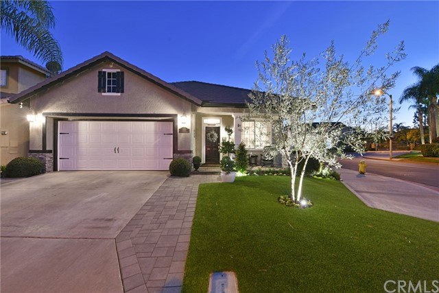 Spectacular Modern One Level Corner Lot Home in Gated Fairways at Alta Vista. This gorgeous property offers fabulous upgrades and amenities including: plank tile flooring throughout, remodeled kitchen with white cabinets, quartz countertops, oversized center island with bar, arabesque tile backsplash, large farmhouse sink, stainless steel appliances including vent hood, barn doors to pantry, dining room offers upgraded desk niche with quartz counters, slier to backyard, gas fireplace with white stacked stone front, family room with modern fan with light, floating in wall cabinet, entry chandelier, large main suite with fan, drapes, slider to backyard, walk in closet with built ins, remodeled bath suite with dual sinks, quartz countertops, walk in shower with floor to ceiling subway tiles, extra large mirrored medicine cabinets, upgraded plumbing and light fixtures throughout, both secondary bedrooms are good sized and have fans, solid wood closet doors, and closet built ins, wonderfully hard-scaped front and back yards with custom pavers with in ground drains, Alumawood patio cover with fans, Malibu yard lighting, attached wall trellis, front porch, artificial grass, upgraded exterior fixtures, painted roof, other upgrades include: baseboards, recessed lighting, linen closet and Nest thermostat, gated community, association pool/spa/playground and award winning schools