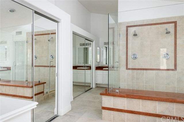 Master suite bathroom with double closets and a HIS SIDE and a...