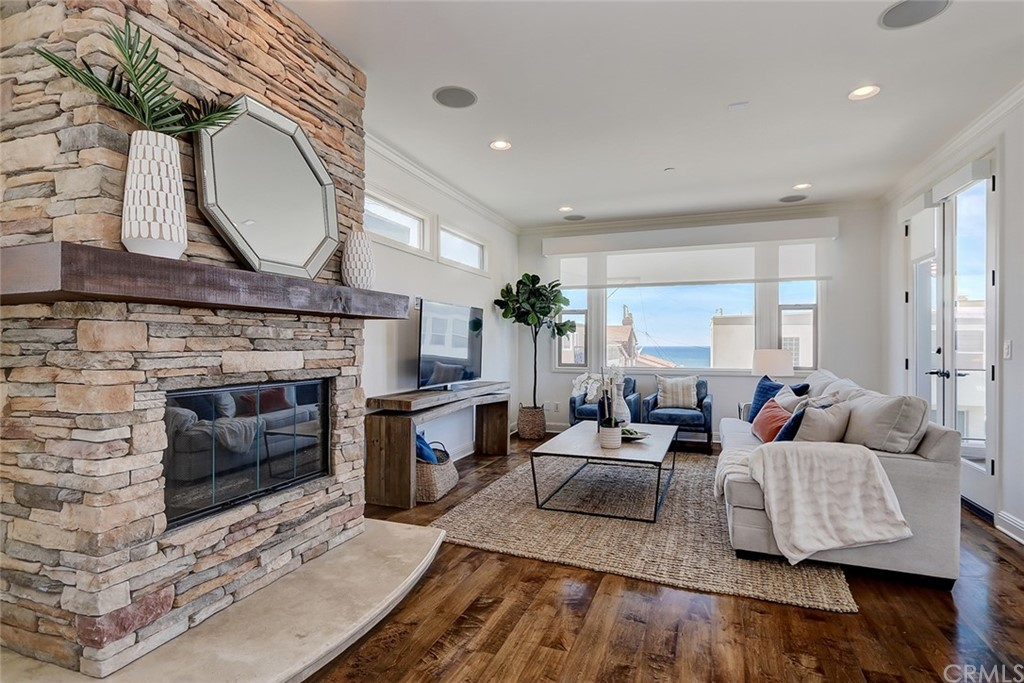 Beautiful stacked stone fireplace in this bright and spacious living room offering big views in every direction