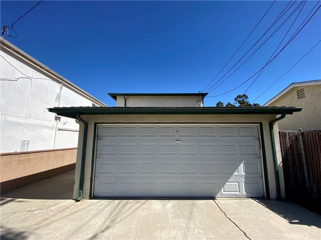 Rear garage share by B & C