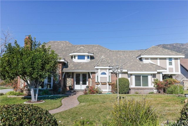 GORGEOUS FRENCH NORMANDY TRADITIONAL ESTATE IN BLAISDELL RANCH. Newly renovated Chef's kitchen with top-of-the line stainless steel appliances, island, & Tanzanite stone counters. Formal Living and Dining Rooms. Grand sized Family room includes a refreshment center plus fireplace and cathedral vaulted and beamed ceilings. Loft area provides for the perfect guest, hobby, or play room. Newer upgraded bathrooms. Newer flooring. Newer dual pane windows & doors. Newer cabinetry. Sparkling pool and spa with stuGORGEOUS FRENCH NORMANDY TRADITIONAL ESTATE IN BLAISDELL RANCH. Newly renovated Chef's kitchen with top-of-the line stainless steel appliances, island, & Tanzanite stone counters. Formal Living and Dining Rooms. Grand sized Family room includes a refreshment center plus fireplace and cathedral vaulted and beamed ceilings. Loft area provides for the perfect guest, hobby, or play room. Newer upgraded bathrooms. Newer flooring. Newer dual pane windows & doors. Newer cabinetry. Sparkling pool and spa with stunning panoramic mountain views provide the focal point for summer barbecues. Backyard also features built in barbecue, large outdoor eating area, plus a private Bocce ball court. Long and wide gated driveway leads to 3-car total garages with separate gated parking area. Lush, park like grounds on nearly 1/2 acre exudes privacy in a picturesque setting in one of Claremont's most prestigious neighborhoods. Coveted Chaparral Elementary School. Private Blaisdell Ranch Park Preserve nearby.