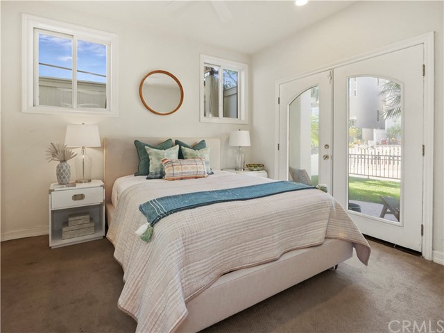 bedroom 3 with private bath and private french doors overlooking grassy yard