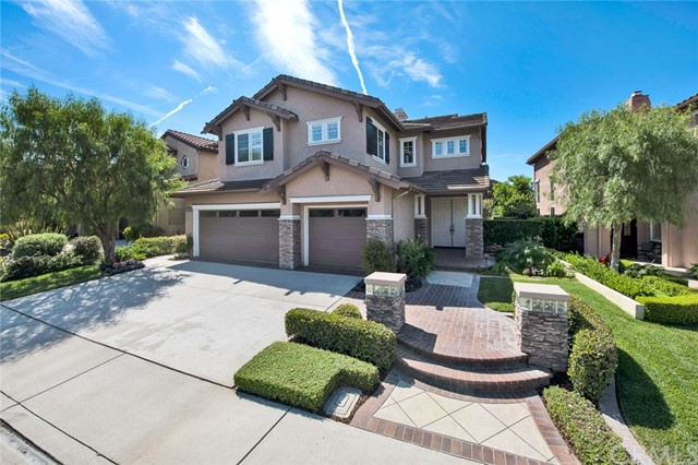 Welcome to 11664 McDougall, a Gorgeous Tustin Ranch Dream Home Located in the Gated Community of Columbia Westmont! This Highly Sought-After Interior Location Boasts Four Bedrooms (One Bedroom and Full Bathroom on the Main Floor), Three Total Bathrooms, Large Bonus Room, Plantation Shutters, and Ample Natural Light Throughout. The Gourmet Kitchen Enjoys Ample Counter and Cabinet Space, Island with Seating, Walk-In Pantry, Double Oven, Breakfast Area, Overlooks the Backyard, Opens to the Family Room, and Enjoys Backyard Access. The Family Room Features a Cozy Fireplace and Built-In Cabinets. The Dining Room Sits Adjacent to the Kitchen and Opens to the Living Room Showcasing a Soaring Ceiling. The Master Suite Includes a Large Walk-In Closet, Attached Master Bathroom with Dual Vanities, Makeup Vanity, Walk-In Shower, and Separate Tub. Indoor Laundry Room with Built-In Cabinets and Sink. Attached Three Car Garage with Direct Access. The Low Maintenance Backyard Has Artificial Grass and a Pergola Covered Patio. Walk to Blue Ribbon Peters Canyon Elementary/Pioneer Middle School, Citrus Ranch Park, Cedar Grove Park, and Peters Canyon Trails. Minutes to Irvine/Tustin Market Place, Tustin Ranch Golf Course, Walking/Hiking/Biking Trails, 261/241 Toll Roads, and the 5 Freeway. 11664 McDougall is a Must See!