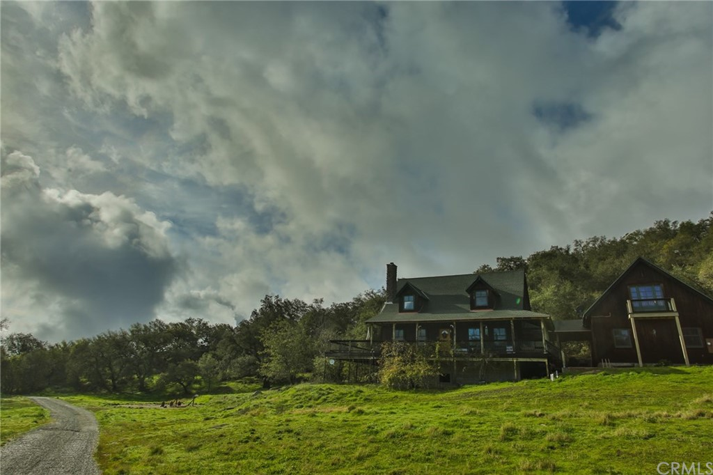 """Welcome to""""The Majestic"""".The ultimate in privacy!Tucked away on the Santa Rosa Plateau,The Majestic sits on 4.98 acres of rare So Cal land.Enter on a private driveway through a tunnel of trees.As you break through, you will see the expanse of open space.Home is perched atop the property.Make your way to the top of the hill, find this incredible rustic style home w modern conveniences.This country beauty is appx 2420 sqft of intelligently designed open living space.Enter the Great Room w knotty pine flooring,volume ceilings & huge River Rock wood burning fireplace.Open kitchen w beautiful pine cabinets & eat at quartz counters.Lower level bath w pedestal sink & clawfoot tub.First floor bedroom w views of the woods.Upstairs loft/office overlooks lower level.Large master suite w high ceiling,walk-in closet & jetted tub.Appx 1200 sqft deck spans 3 outdoor areas overlooking the extremely private land & oak forest.2 car garage w workshop,above garage finished work space w private interior door.Land w expansive open space,views galore,mature oak tree forest,seasonal running stream & pond.3 smaller structures also on property;barn,chicken coup & playhouse.Owner w blueprints,approved plans & structural features for a bedroom/bathroom addition to enclose the breezeway.A one of a kind in SoCal.Install a barn,run your horses,host weddings,photo shoot or fam picnic.Possibilities are endless!The serenity of the country,only a handful of minutes to freeway, restaurants & entertainment."""