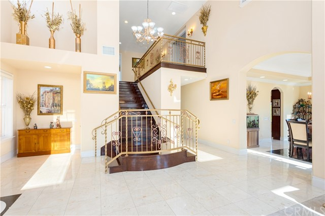 View of Grand Staircase leading to 4 Bedrooms and 2 Full Bathrooms.