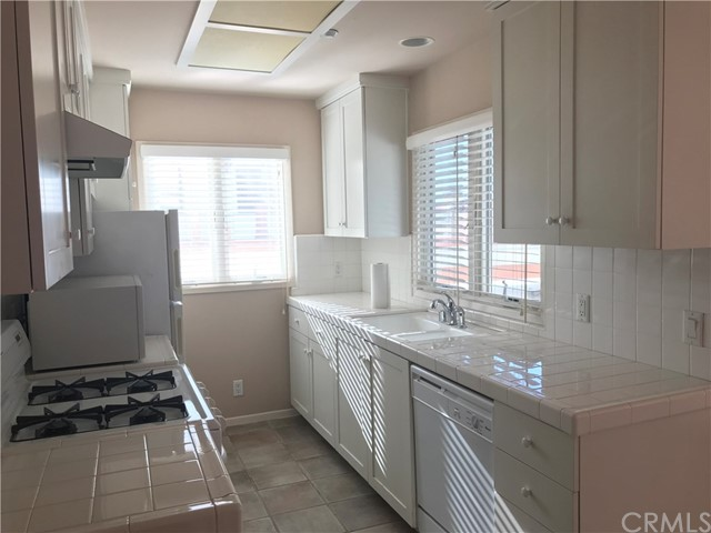 Furnished one bedroom apartment with parking in back of walk street single family home.  West of Highland with ocean view from patio and living room. Walk to downtown and beach.  Has washer and dryer in unit and free cable. Large parking spot in car port.