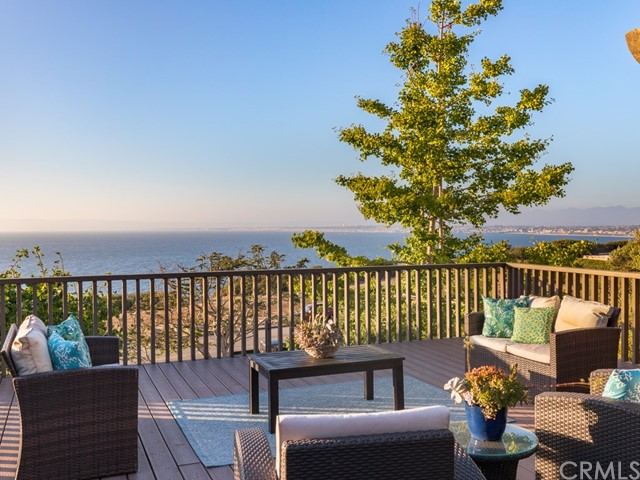"Fabulous Ocean Views! This rejuvenating ""Retreat"" sits removed from the busy life of LA & adds coastal bliss to those who venture here. The bluff trails, ocean & loads of natural beauty are right out the front door. The variety of views include Panoramic Ocean, Mountain & Bay views. You can see downtown LA in the distance as well. This special home was custom built in the 60's and almost every room has an ocean view. No kidding. What is considered by some to be the original California surf spot, ""Paddleboard Cove"" is just outside. It's easy to be excited about this calming, out of the way place. On one of the premier streets on the hill, the property has parkland directly in front of it. The home was custom designed by Frank Wilson. This is the ""Margate"" area of Palos Verdes Estates with name roots all the way back to England. The home has ""open to the sky"" windows, wood beams that make almost all of the interior walls non-load bearing, a brand new heating system, 6 bdrms, office, 5 bths, banquet room & mud room. The large outdoor deck is a slice of paradise. It's post & beam construction. The popular ""Hollywood Riviera"" is 2 miles away. Malaga Cove is near. 4 Golf courses are not far, as is Terranea Resort."