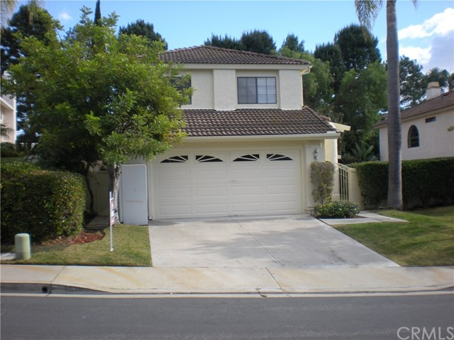 """A gem in Rancho Niguel. This home is on a single loaded street it has three good sized bedrooms with plenty of closet space. Re-modeled Master Bathroom. The large kitchen has been upgraded with granite counter tops, a cozy family room with fireplace and a huge living/ dinning room with hi vaulted ceilings and new flooring. The garden is large and has two covered patio areas. To enter the garden from the front of the house you will come through a gated courtyard into a well maintained garden. Rancho Niguel """"The Club"""" recreation center featuring pool, tennis, sports courts, racquetball, exercise, park like area with BBQ's and a children's playground which you may join. Directions North on Crown Valley, left Nueva Vista, right Vista Rancho"""