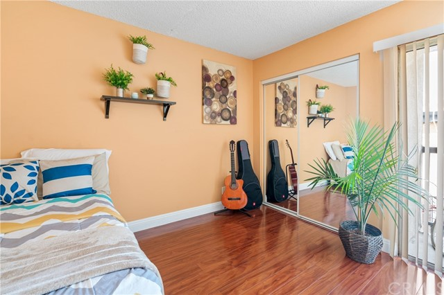 Second room located at the second floor with laminated wood and patio.