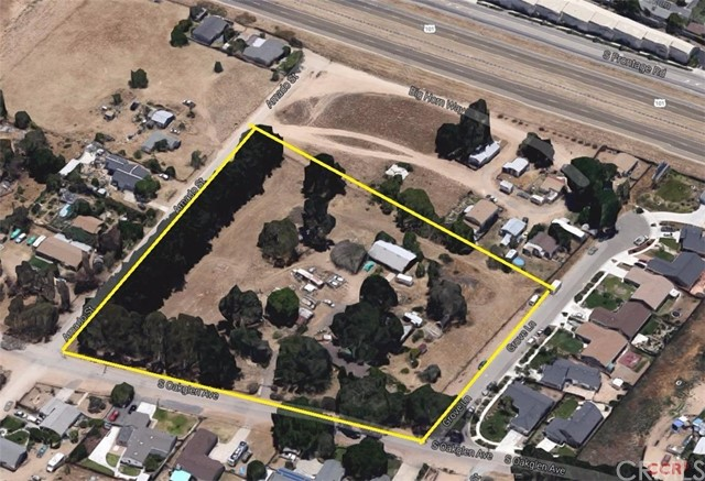 Potential development property consisting of 2 parcels totaling 4.42 acres with two APN's. Level and can be seen from the freeway, but does not abut the freeway. Two homes and storage buildings on the property. Zoned Residential Single Family, and can be split into min lot size of 6000 sf per County.