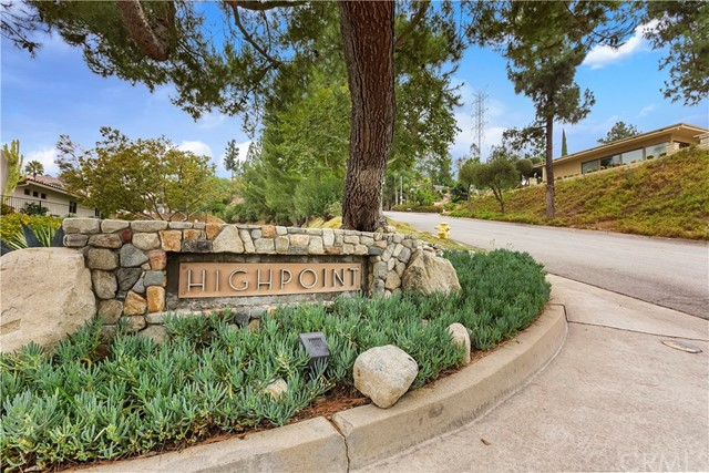 Do not miss this opportunity, rarely do these gorgeous Highpoint condominiums come available! Beautiful, well-maintained view condo situated on the second row atop the exclusive Highpoint community. This single-story condo offers 1,585 square feet of living space and gorgeous views of the canyon. You will enter the gated courtyard leading you into a nice floor plan with lots of natural light making the space bright. There is ceramic tile throughout with carpeted bedrooms. The kitchen opens to the dining and living room with fireplace. In the master bedroom you will find your private master bathroom that features dual sinks and vanity area and access to the back patio. The second bedroom is spacious and right down the hall is the second bathroom. On your back patio, you can enjoy sunset views, the canyon below or morning sunrises while drinking your morning cup of coffee. In addition to all the wonderful indoor features, this property has a newer a/c and heating units, roof, and tankless water heater. You will be close to many of the special things that make Claremont home: shopping in the Claremont Village, dining out, schools, many parks and the Thompson Creek trail to name a few. Please note, some photos have been virtual staged, property comes unfurnished. A virtual tour is available at https://my.matterport.com/show/?m=H3td63ZS8dx&brand=0.
