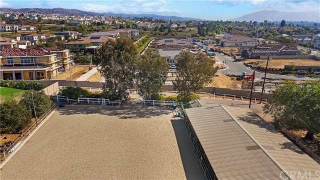 Your slice of horse heaven in the heart of the city awaits you! Views of Catalina to the west and horse facilities surround behind you. A great business opportunity as a horse boarding/training facility as well as TWO homes which is currently zoned for 28 horses. The property has its own private driveway as well as secluded parking for guests. 2 flat acres of useable land. The main home of approximately 1200 sqft has been recently upgraded including a new roof, HVAC, kitchen and room addition. The master has a walk in closet and the privately fenced yard has raised flower/vegetable beds, artificial grass, and lighting. The second house is approx. 800 sqft two bedroom, one bath and does need repairs. There is a laundry room inside the main house, hook ups in a storage unit near the barn, and in the second house. While zoned for 28 horses, there are currently 25 stalls, a 50' round pen and a lighted 100'X200' sand arena. Stalls include~FIVE 12X24 FCP welded wire mare motels, FOUR 12X12 box stalls with 12x12 runs attached, ONE 12X24 1/2 covered pen, FIFTEEN stall mare motel with SIX 12X24 and NINE 16x16 stalls. 28 privately locking tack lockers. There are storage units including TWO 12X12 units which could be used as feed/tack rooms, 14X12 office, 10x16 Tuff Shed, and a 2 car garage with storage building attached. There is ample room to drive a trailer in and out without ever having to back up.  There are ample cross tie areas with a hot water heater for washing horses.