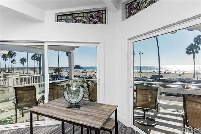 Location; Location; Locarion..... Oceanfront Duplex located in the heart of Newport Beach.  Beautifully remodeled from top to bottom.  Spacious floor plans on both units. Both units have  stunning ocean views from Laguna beach to Long Beach.  Top unit is spacious large two bedrooms and three bathrooms.  Beautiful kitchen with granite counters; all new stainless steel appliances. Romantic fireplace; vaulted ceilings, large patio, balcony to enjoy your gorgeous ocean views.  Steps away from the Newport pier; surfing, bike riding, walking on the boardwalk, walk to fabulous restaurants.  Walk 100 yards across to the beautiful bay.  Boating, kayaking, paddle boarding.  Upstairs unit has French doors to large patio over garages.  Private stairway to rooftop.  Beautiful stain glass windows throughout.  Ceiling fans throughout, gorgeous large showers with beautiful marble n tile.  Skylights to enhance even more lighting.  Down stairs has three spacious bedrooms with two baths.  Open patio to entertain or just relax and people watch.  Each unit has a garage with another parking space behind the garage.  4 parking spaces.  One with direct garage access.each unit has washer n drier.  Great potential for Income property.  Live in one unit and rent the other unit.  Newport Beach being one of the world destination spots these units, duplex's will always rent and bring fantastic income.  Vacant and ready to move in or rent... oceanfront properties are rare with such a great location.