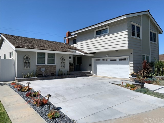 Check all the boxes when it comes to what you want for the ultimate family home.5 bedrooms-1st floor Master Suite with dual closets and huge walk-in.2 large upstairs bedrooms with a central family/bonus room,perfect for teenagers or young adults.2 additional downstairs bedrooms,one perfect for a home office.Check!3 bathrooms-remodeled dual sink master bath with travertine tile(dual flow shower heads and granite counter vanity.Downstairs full guest bath with dual sink and wainscoting.Upstairs bath allows for a self sustained living space.Check!Large Remodeled Family Kitchen-Granite counters with tons of cabinet and counter space,one year old dual oven,5-burner Dacor gas stove top and recessed lighting, all opening to the dining and living rooms for a great open feel. Check!Entertainer's backyard - Sparkling heated pool, relaxing spa, built-in BBQ w/bar and Lynx grill, and pergola style patio cover. Check! Cul-de-Sac-Feels like a private street with limited traffic.Highly Rated Schools-Walk to the elementary school; middle and high school within minutes.Water Close-Water sports and beach activities are within minutes or a short bike ride. Freeway Close - Save time with shuttling the family to all their events.This home includes exterior stone veneer facade, dual pane windows throughout,crown molding, dual sided fireplace,and drought tolerant landscaping and lighting.NEW ROOF and NEW EXTERIOR PAINT just done!Everything you want and need for your family home! Check! Check! Check!