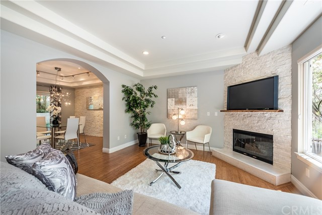 Unbeatable LOCATION. Close proximity to the beach and the 3rd Street Promenade as well as just steps from famed Montana Avenue shopping and dining. This 3 story townhome features 3 bedrooms and 2.5 bathrooms with bamboo flooring throughout. Townhome was remodeled in 2012 by a professional designer and the kitchen was completely redone in 2014 (per seller) Stainless steel appliances with a Viking stove. Spacious living and dining area complete with an updated stone fireplace. A nice patio/yard is located off of the dining area. There are two nice size bedrooms, one with a private deck. In addition there is a very spacious and luxurious master bedroom and bath with walk in closet. The master is complete with vaulted ceilings and private deck also complimented by a loft/office. There is a laundry room and a bonus room/Gym/music studio not included in the square footage(Per Seller) on the lower level. ROOFTOP DECK W/ HOT TUB & SEATING AREA,. There's direct access to the home from your large private 2-car garage. There is also guest parking available. The home also has a full security system. You don't want to miss this once in a lifetime opportunity to live in this coveted  Santa Monica LOCATION with just 4 owner occupied townhomes and just a $400 monthly HOA fee.