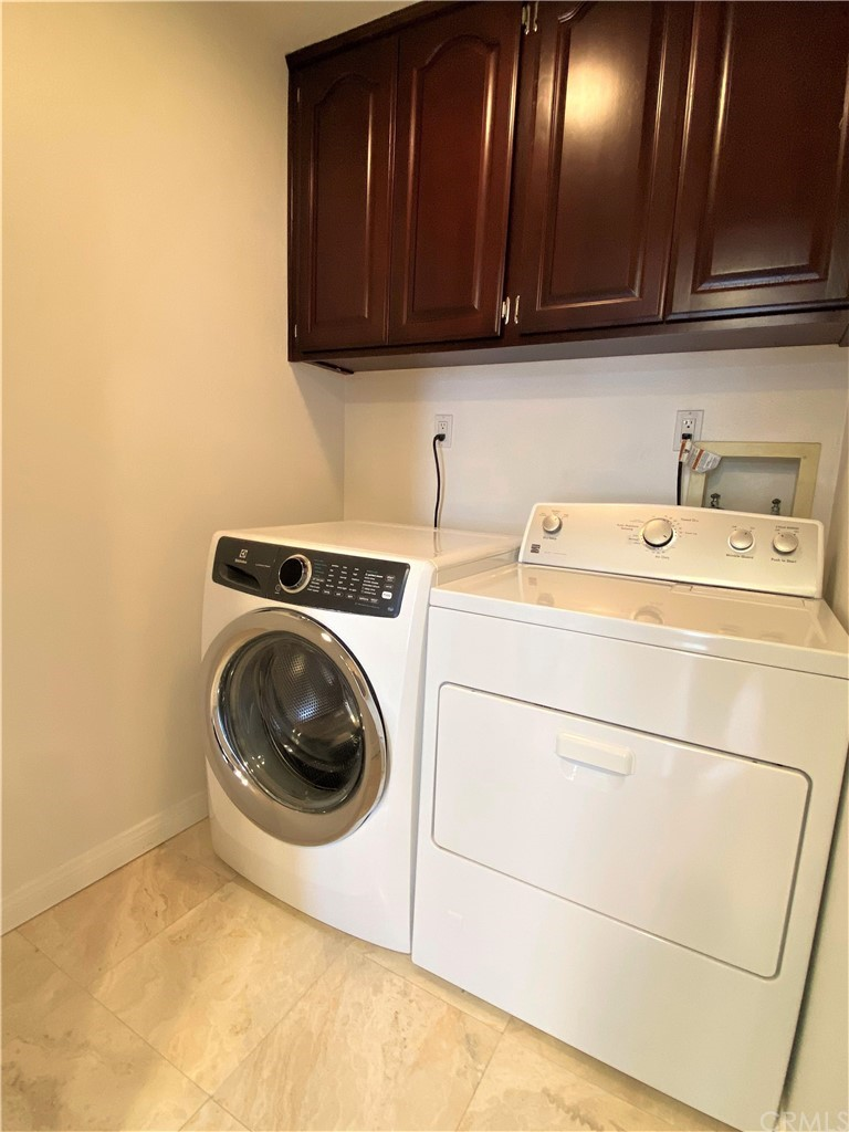 Laundry room with included appliances