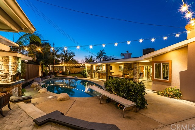 A home is not all about the backyard, but this residence comes close - your own sanctuary with an amazing ambience that invites indoor/outdoor living expected inhomes costing more.This single level lifestyle home is owned by a custom home builder and features a covered patio along with fireplace, pizza oven, large built-in BBQ, fire pit, pergola, thatembraces a beautiful succulent garden and seating areas around the pool.  Make your way inside the house and discover that this 3 bed / 2 bath home encompasses approx 2000 sq ft with thoughtful appointments throughout. Craftsmandetails add unique character to every corner. You'll be hard pressed to find a better appointed home for the price. This is North Tustin living under $1M.