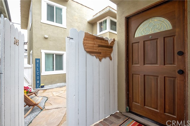 Entry Door To Front House And Sneak Peek Through Gate To Patio & Entrance To Rear Unit