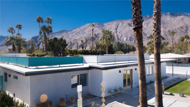 """Welcome to the Oasis in Palm Springs. This is a 'One of a kind Palm Springs masterpiece"""". This property blends a pop minimalist vibe with a swanky gallery-esque. style in a desert spa oasis. Walk through this colorful palate of vibrant mood setting rooms, spatial settings and outdoor artistically designed landscape with stunning mountain views and delightful cactus gardens. This unique property is basically a brand new home. The property was gutted down to the studs and rebuilt. There were additions of 1600 square feet to the existing structure making the total size approximately 3600 sq ft. The main house has 3 master on-suites with a hip modern kitchen with teak custom cabinets and high end stainless steel appliances. The home has cool modern lighting fixtures on dimmer switches and high end finishing's throughout. The back house is a one bed one bath """"Casita"""" with a cool private back patio. There is open floor concepts throughout the property. There are large custom aluminum sliders providing a nice indoor outdoor feel. This gem has too many features to list tem all. There is an outdoor kitchen and beverage bar. This is a fantastic home for entertaining. There are several outdoor seating areas with three different outdoor fire pits with amazing unobstructed mountain views with out any power lines. The pool and oversized spa are brand new with desert colored pebble tech and high end all new equipment.. Enjoy and spread out on the nice large green lawns The developer added a 500 sq ft outdoor covered patio and a 1200 sq ft car port with stylish natural tongue and groove ceilings and recessed lighting. There is a separate spacious laundry room. There is all new HVAC systems and tank-less water heaters throughout. The home has all new electric wiring and panels. There is a new roof and all new hardscape concrete. Come check out and relax at this private secluded desert spa."""