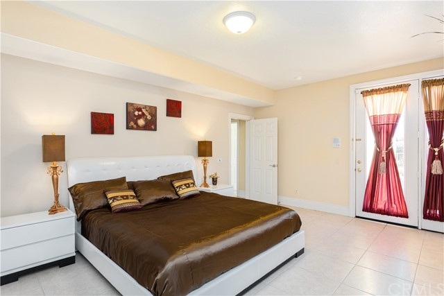 Bedroom in Lower level with French Doors leading to courtyard and Views!