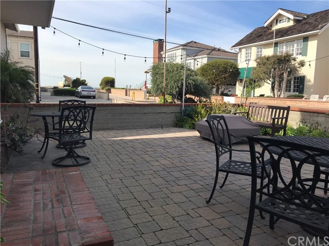 Charming walk street completely furnished 2 bedroom one bath apartment with air conditioning three doors to the strand. Garage with washer/dryer. 6 month lease. 4 blocks to downtown and restaurants. Best walk street north of the pier.