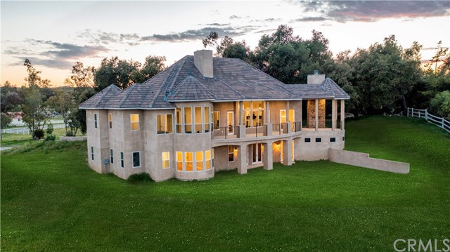 This custom estate sits atop its own hill with amazing views from every room in the house.