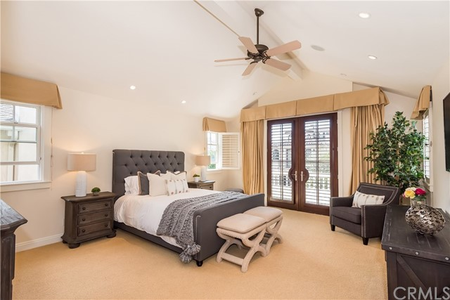 Large Master Suite with vaulted ceilings, French Doors, and a balcony that overlooks the walk street.