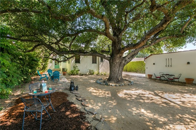 View of the House and Oak Tree from the Back Yard