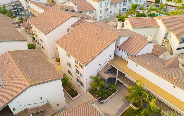 Welcome home! Enjoy this naturally light filled 1 bedroom/ 1 bath condo in the wonderful gated community of Somerset Paramount.  This end unit, which overlooks the courtyard adjacent to the community pool, has a modern open-concept floor plan.  Kitchen has new light fixtures, built in dishwasher (included), stackable washer & dryer (included) and plenty of cabinet & counter space.  Cook up a storm in the kitchen while entertaining guests sitting at the bar height counters.  Unit freshly painted with laminate floors throughout.  Spacious bedroom & spacious closet with a courtyard view.  Full bathroom with plenty of cabinet space and new light fixtures.  Unit has central heat/air.  Home has 1 assigned subterranean parking space along with its own storage unit in the same area.  Community has a pool, spa, BBQ areas & a community room that can be reserved for events and social gatherings.  This community has it all! 24-hour guard & gated community!  Public transportation a plus as the community is close to several Metro Local Lines incl:  22, 266, 127 & 125.  Nearby parks include Progress Park, Pequino Park and Paramount Park. This a your opportunity to stop paying high rents and instead, invest your hard earned dollars in real estate.  What are you waiting for? :)