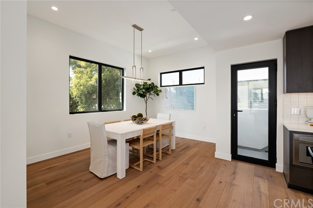 Adjacent dining space filled with natural light and a French door leading to extraordinary views (shown here using reverse of 961 Unit A staging)