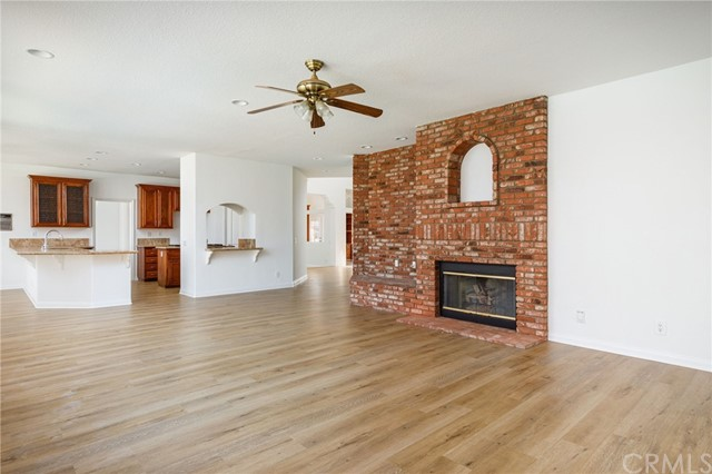 A large open feeling of this room and the kitchen for any size family.